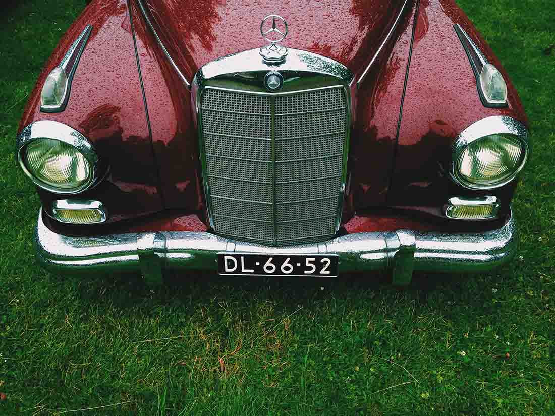 Vintage maroon colored Mercedes Benz front side