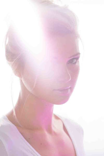 Washed out image of a woman in white with lens flares