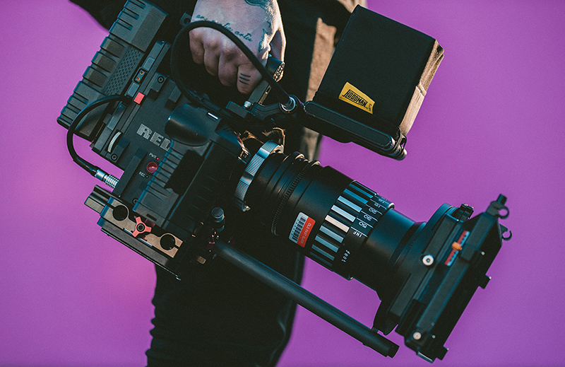 Man Holding a 8K RED video camera