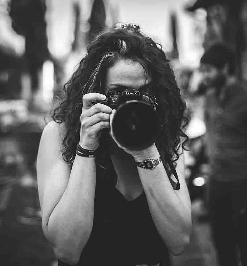 Woman photographer holding a camera to her eye