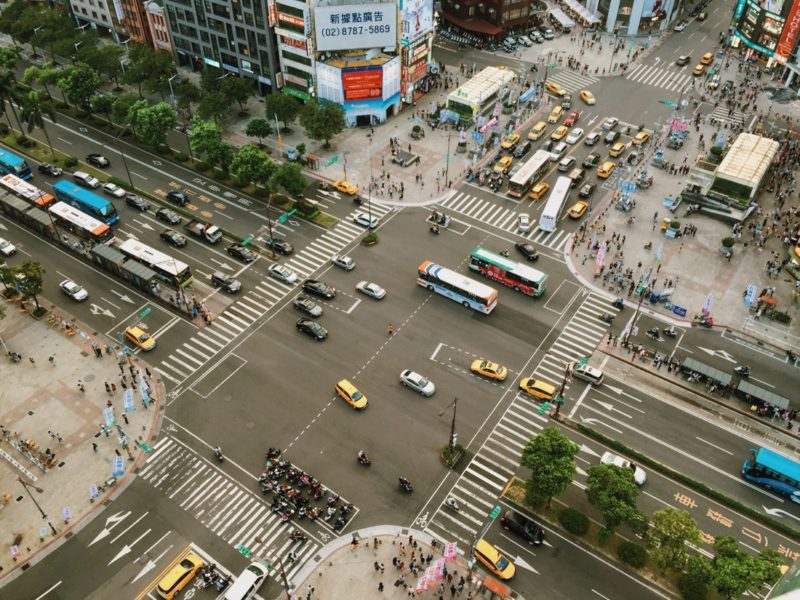 Aerial photograph of cars and buses at a traffic intersection