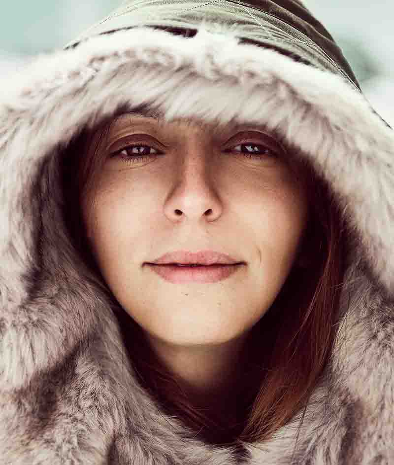 Woman wearing a jacket with a hood