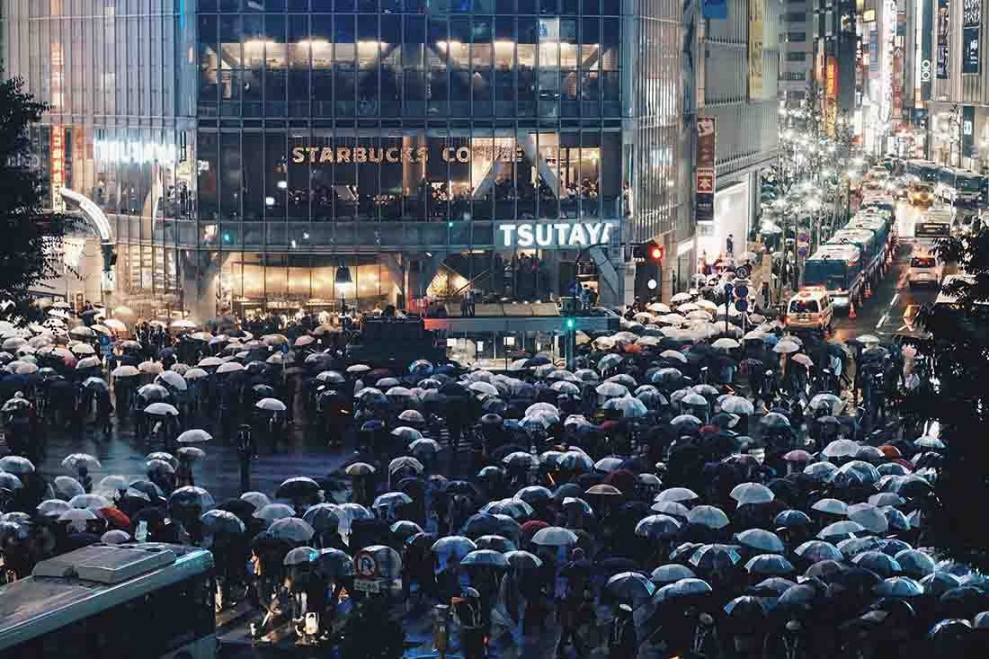People scrambling for cover from the rain in Japan Tokyo