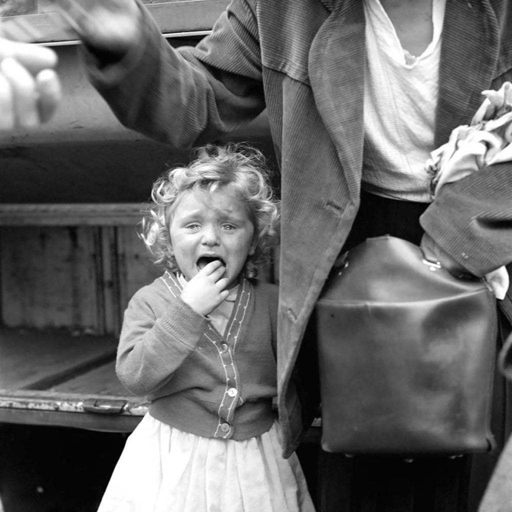 Vivian Maier's photograph of a baby girl crying black and white