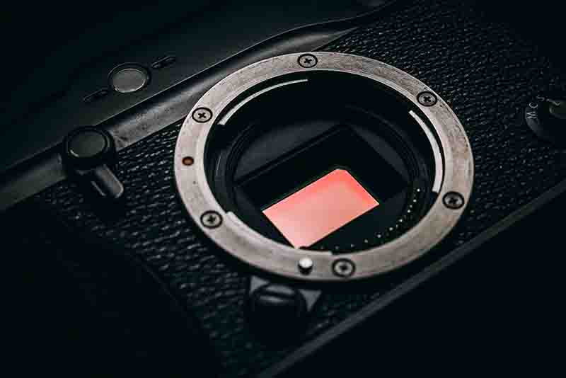 macro image of an exposed camera sensor on a black camera body
