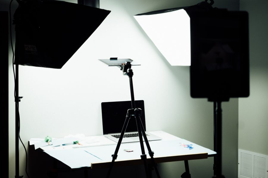 a desktop setup of light and camera for shooting stop motion animation images