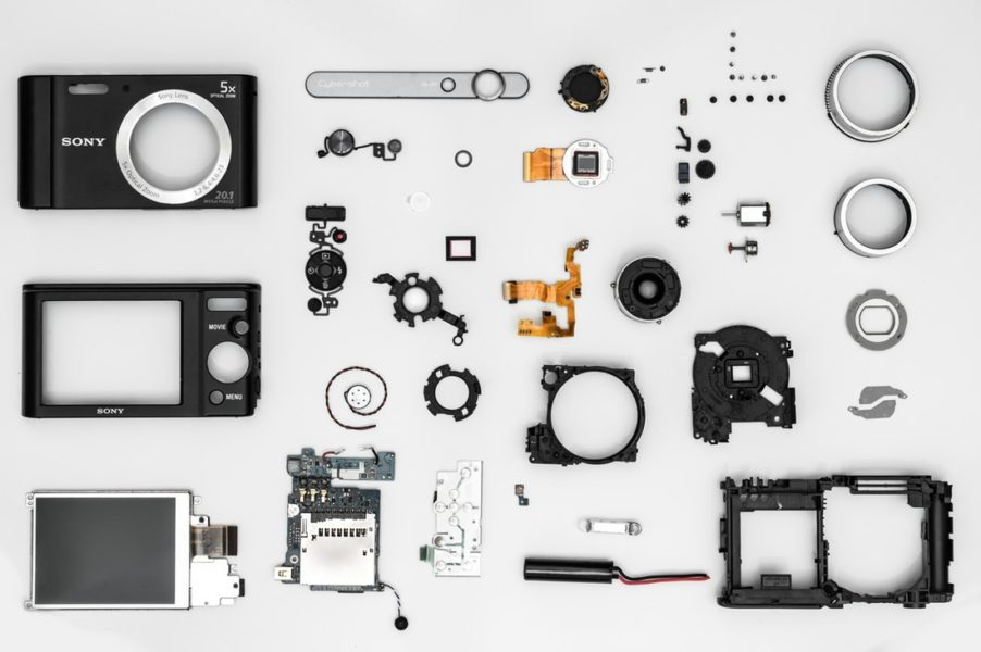 disassembled sony camera lying on a tablw with all the parts exposed