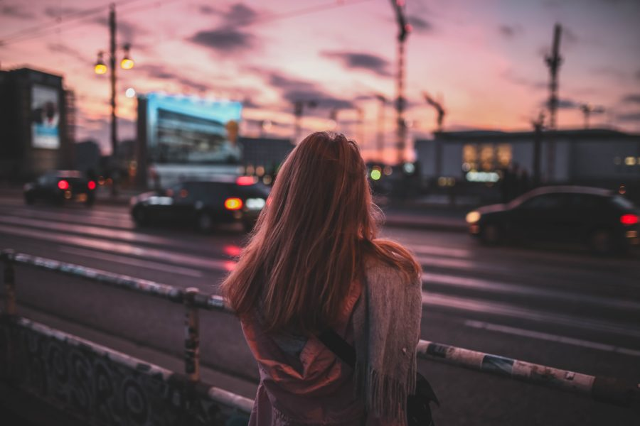 Woman beside a road at dusk with beautiful muted colors