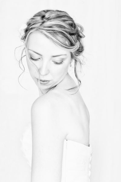 high key image of a Christian bride in her wedding gown against a pure white background