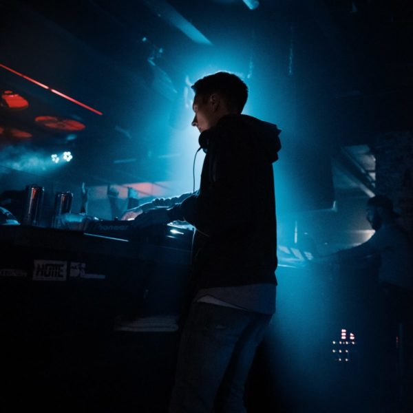 DJ playing music in a night concert
