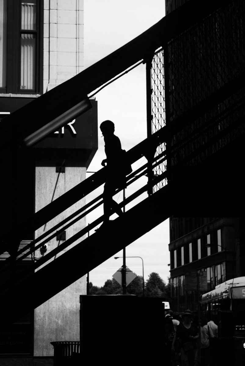 Contrasty image of a person coming down a flight of stairs