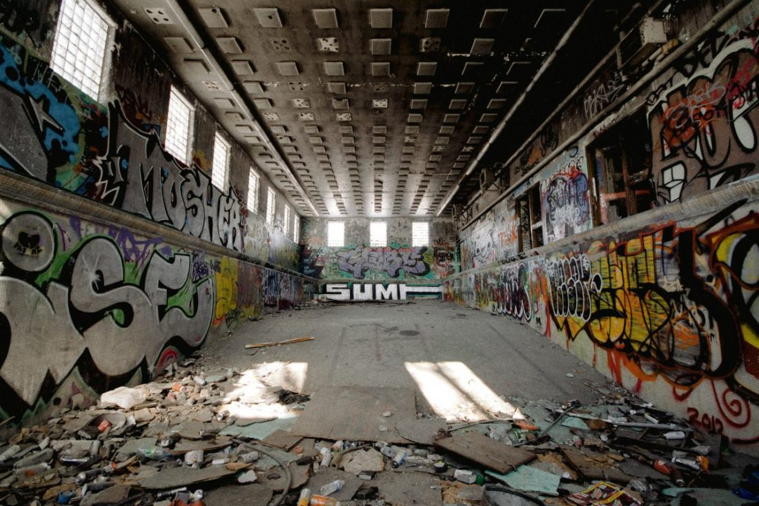 Wide angle shot of a abandoned building filled with graphitti