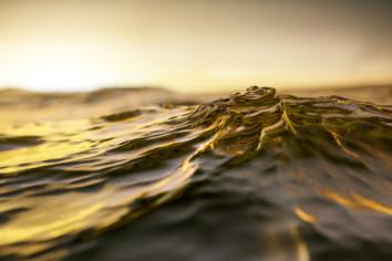 Sea water swelling as dusk