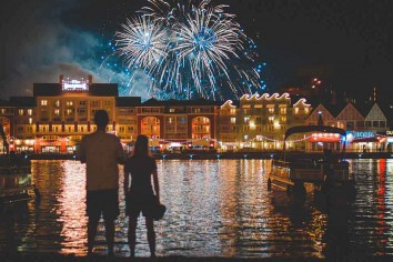 Couple doing fireworks photography at Disney's Boardwalk Resort, Kissimmee, United States