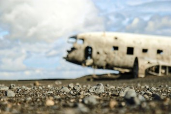 Out of focus, blurry image of an airplane crashed in the desert
