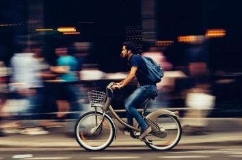 Panning shot of a man on a bike