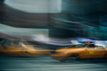 Reciprocal rule Photography written with a blurry image of a yellow taxi in the background
